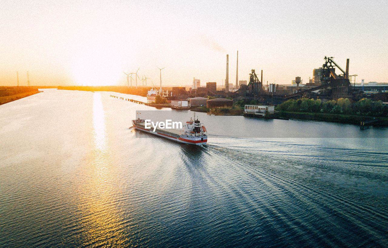 nautical vessel, transportation, water, mode of transportation, sky, waterfront, architecture, building exterior, built structure, nature, city, ship, sea, no people, sailing, travel, outdoors, sunset, passenger craft