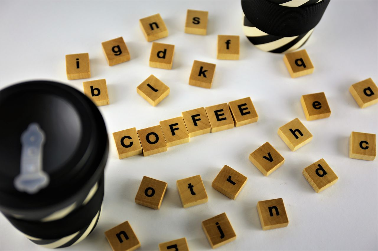 still life, indoors, high angle view, communication, text, large group of objects, letter, no people, close-up, alphabet, western script, table, capital letter, technology, leisure games, shape, studio shot, number, toy block, toy