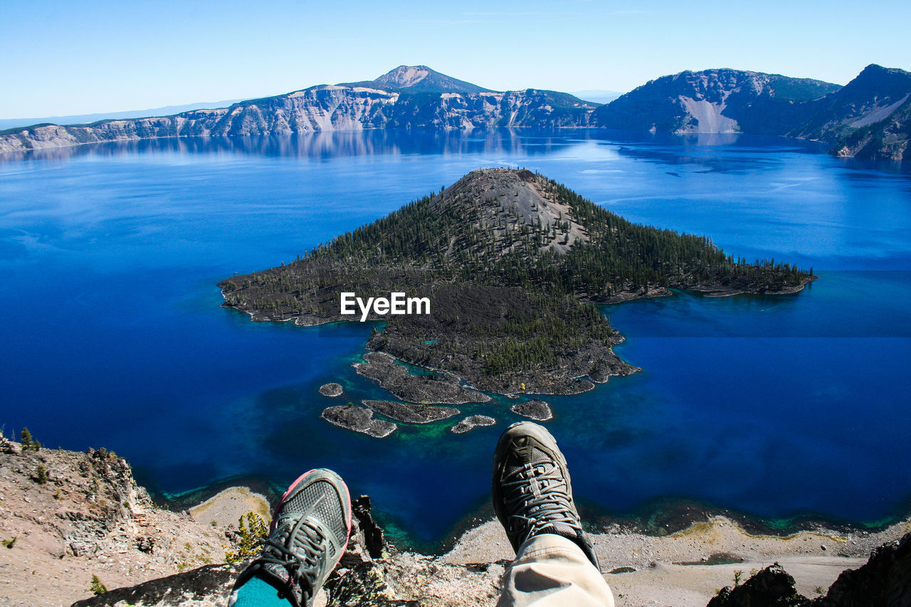 Low Section Of Person Against Crater Lake