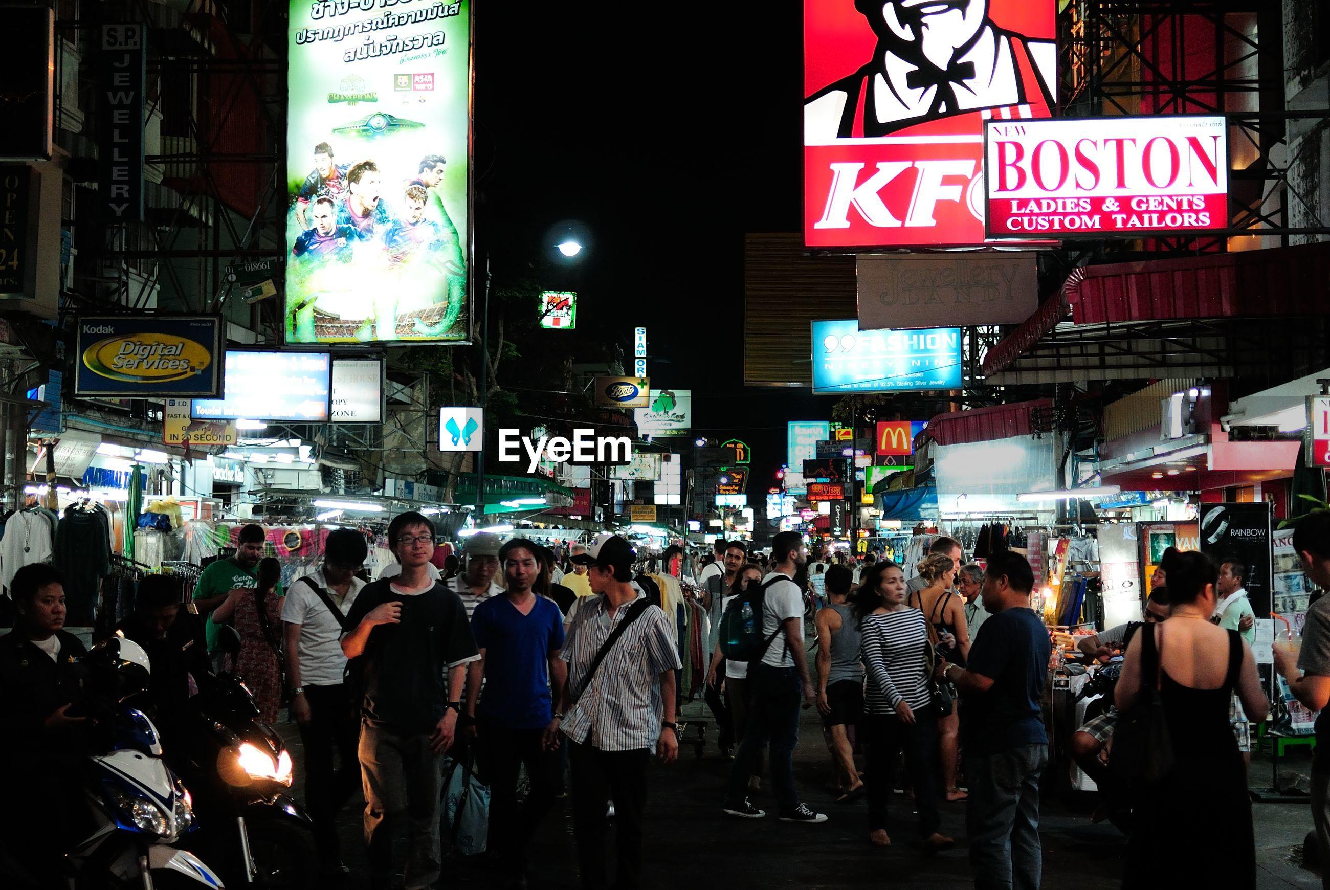 Crowd on street market at night