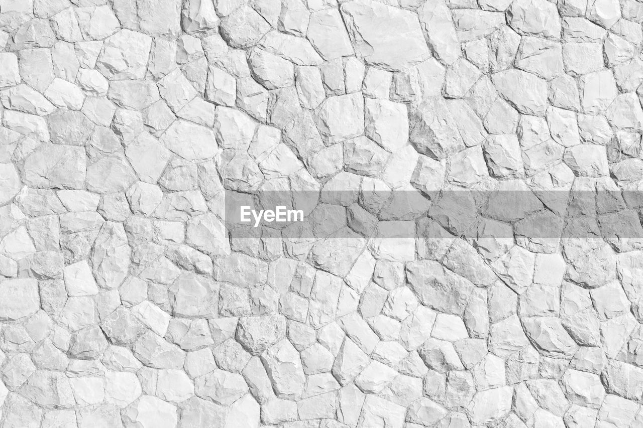 backgrounds, full frame, textured, no people, pattern, white color, abstract, outdoors, solid, wall, cracked, stone - object, copy space, brick, wall - building feature, concrete, textured effect, construction material, large group of objects, street, breaking, abstract backgrounds, cement, blank, stone wall