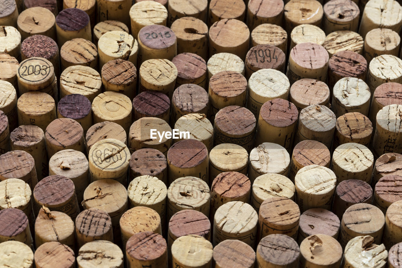 cork - stopper, wine cork, large group of objects, wine, backgrounds, full frame, alcohol, abundance, refreshment, drink, food and drink, no people, indoors, bottle, still life, shape, arrangement, container, close-up, in a row, winemaking