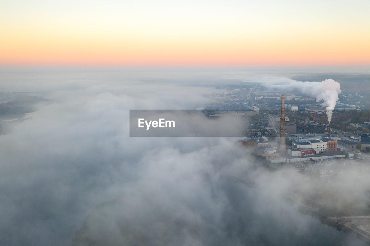 Aerial View Of Industry Emitting Smoke Against Sky