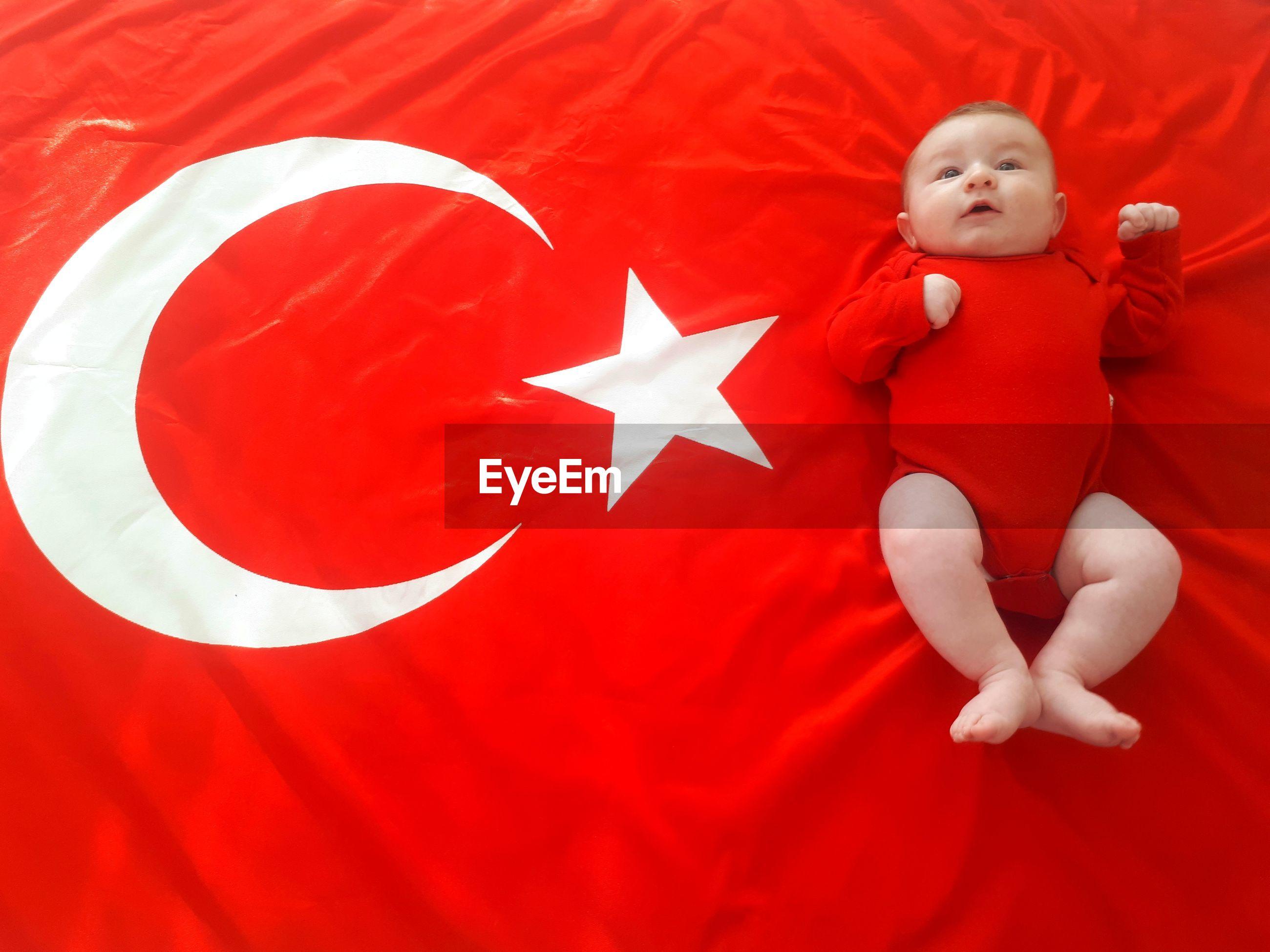 Full length of child lying on flag