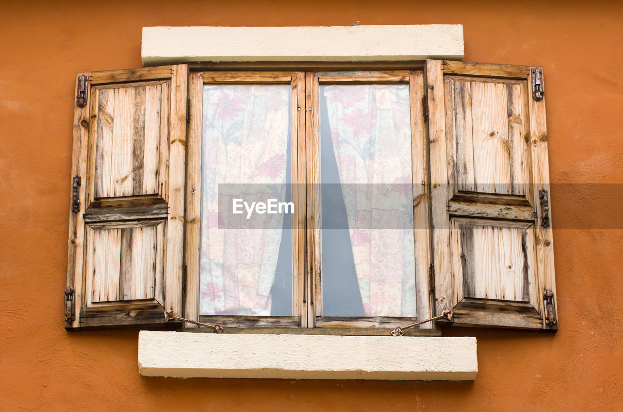 Close-up of window on wooden wall