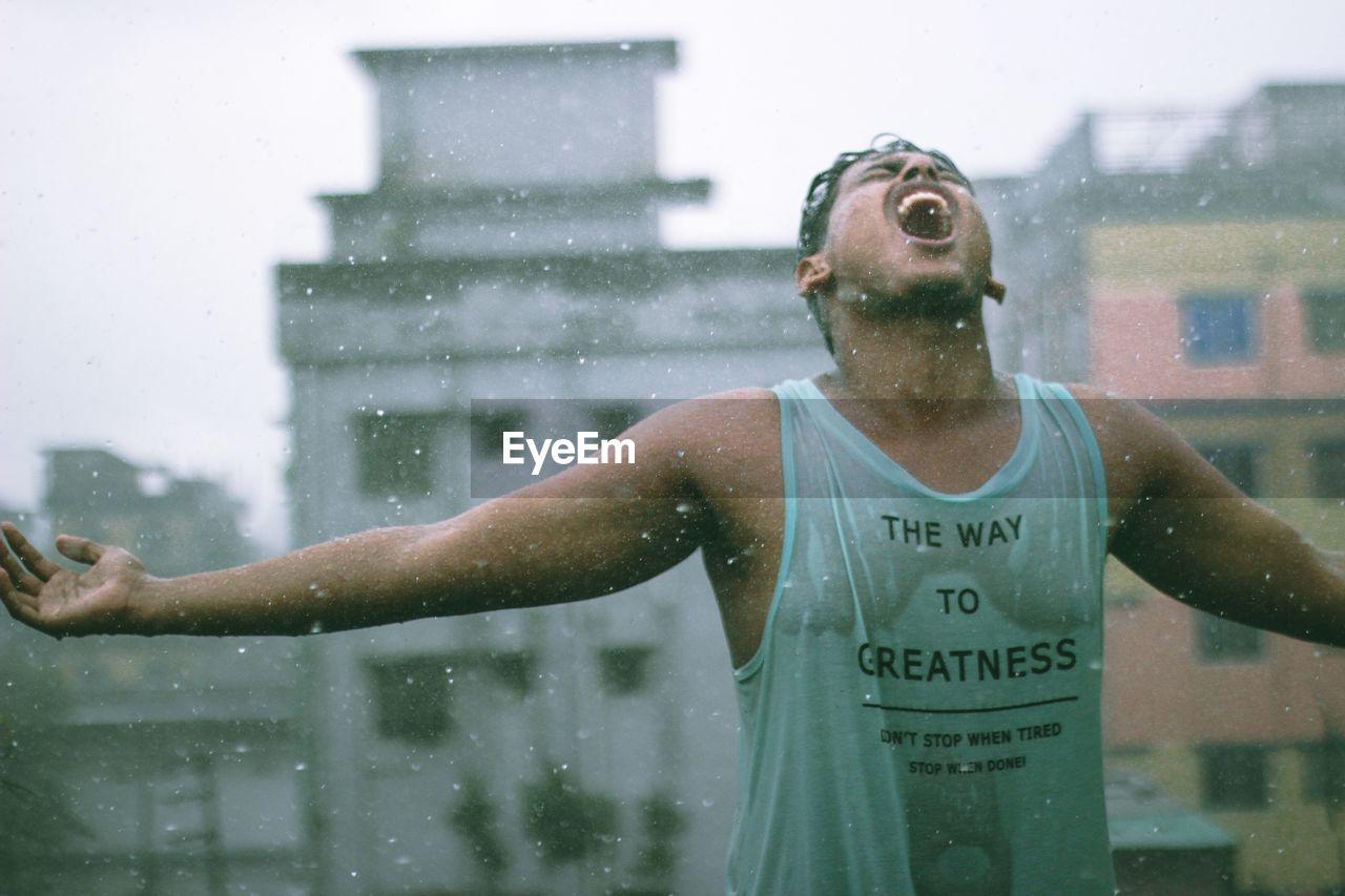Man Shouting During Rainy Season