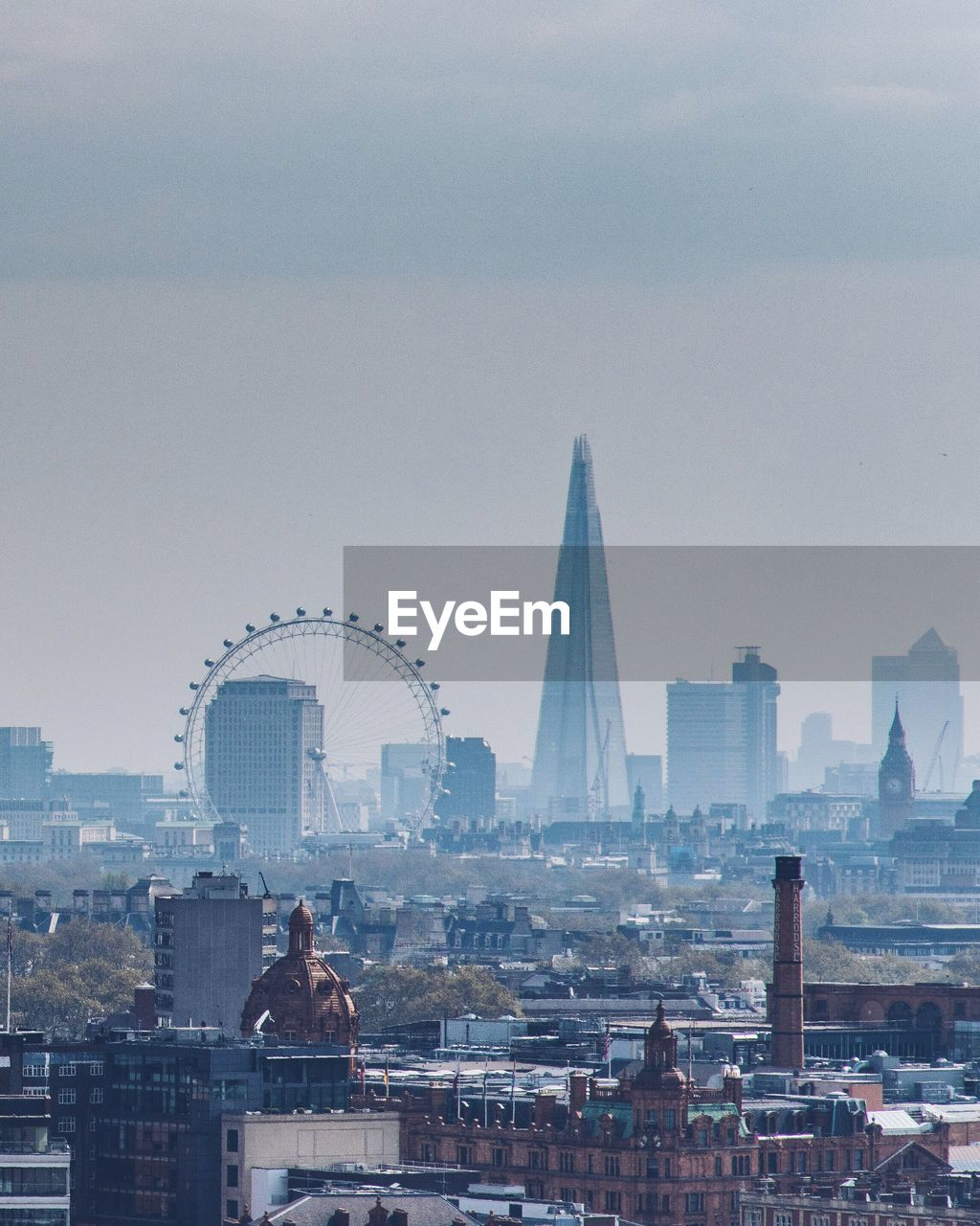 London Eye And Shard In City Against Sky