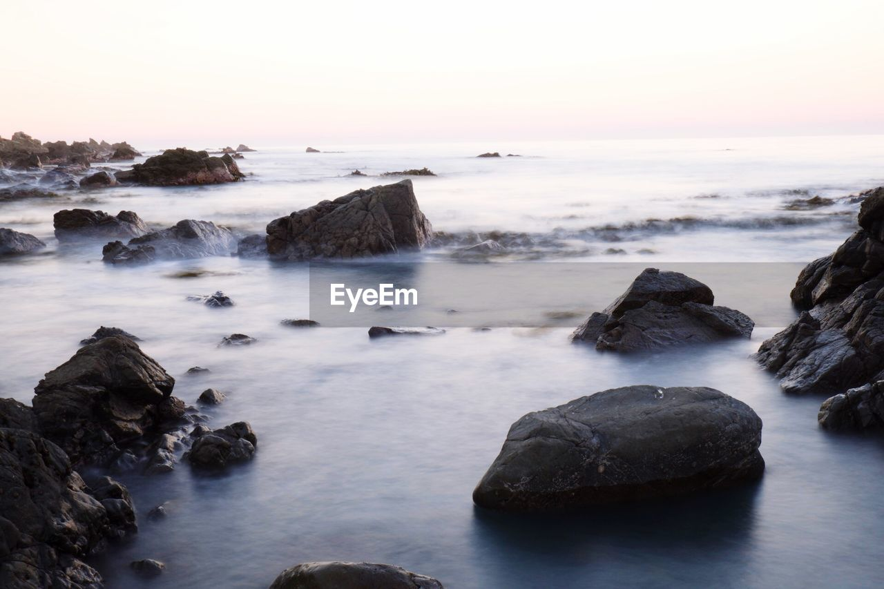 rock, water, rock - object, solid, sky, beauty in nature, sea, scenics - nature, long exposure, tranquility, motion, tranquil scene, sunset, nature, no people, idyllic, blurred motion, beach, land, horizon over water, outdoors