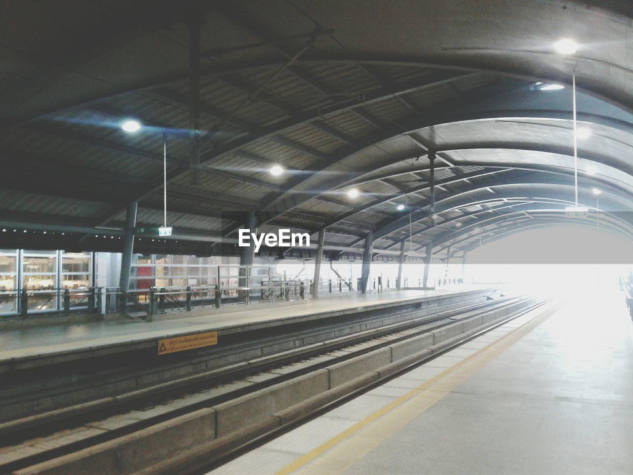 transportation, indoors, rail transportation, illuminated, empty, railroad track, railroad station, railroad station platform, public transportation, no people, day