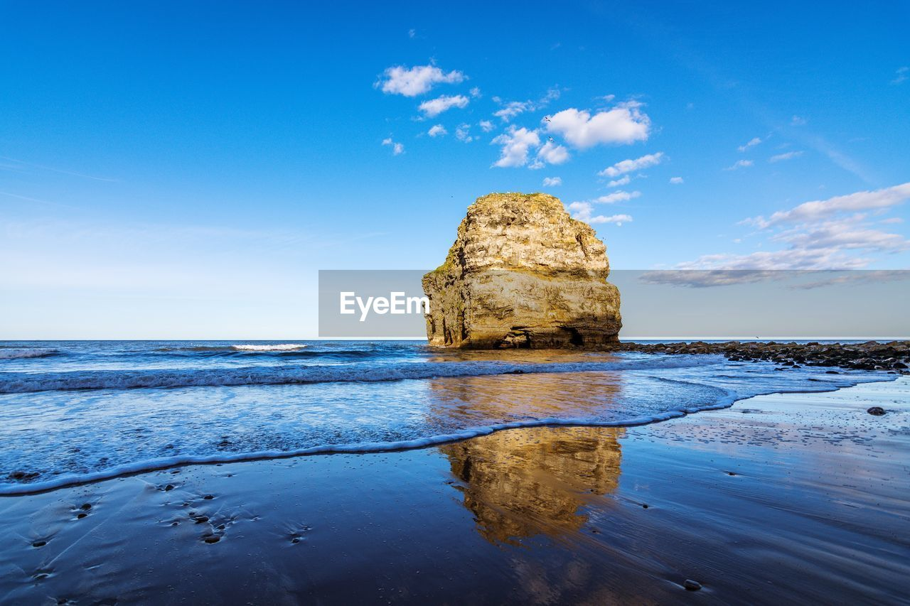 tranquil scene, sky, beauty in nature, scenics, water, nature, tranquility, sea, reflection, blue, rock - object, outdoors, horizon over water, cloud - sky, no people, waterfront, day