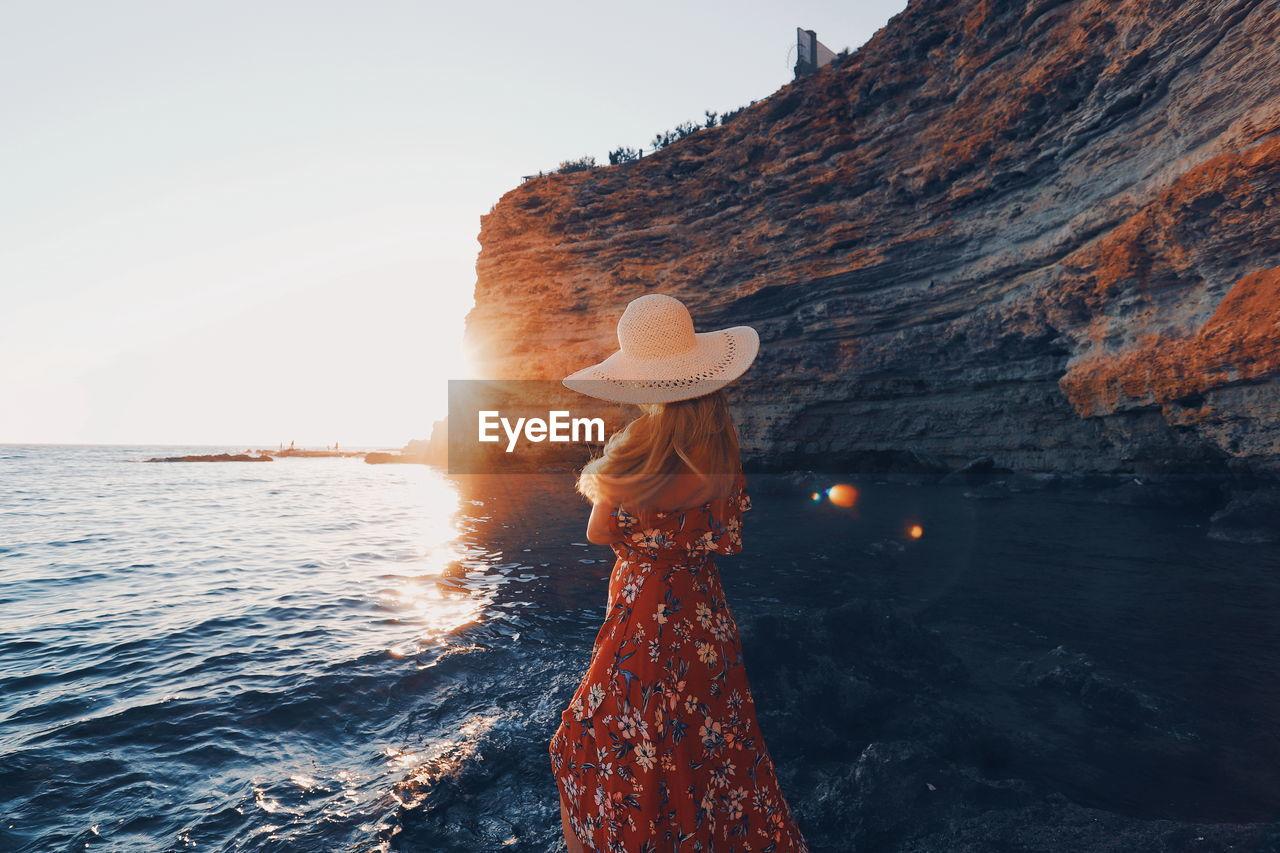 Woman Standing Against Sea At Beach