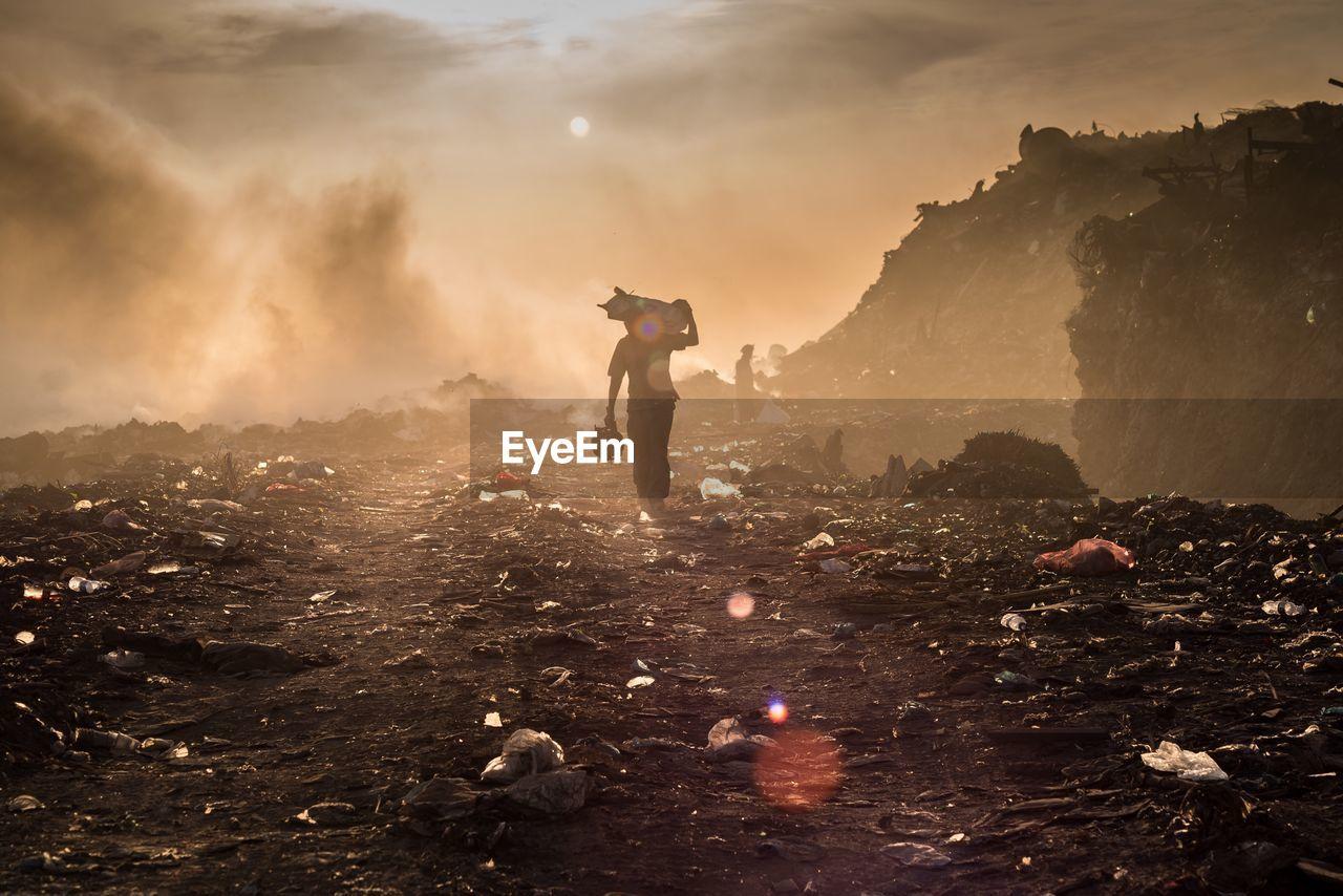 Man walking at landfill
