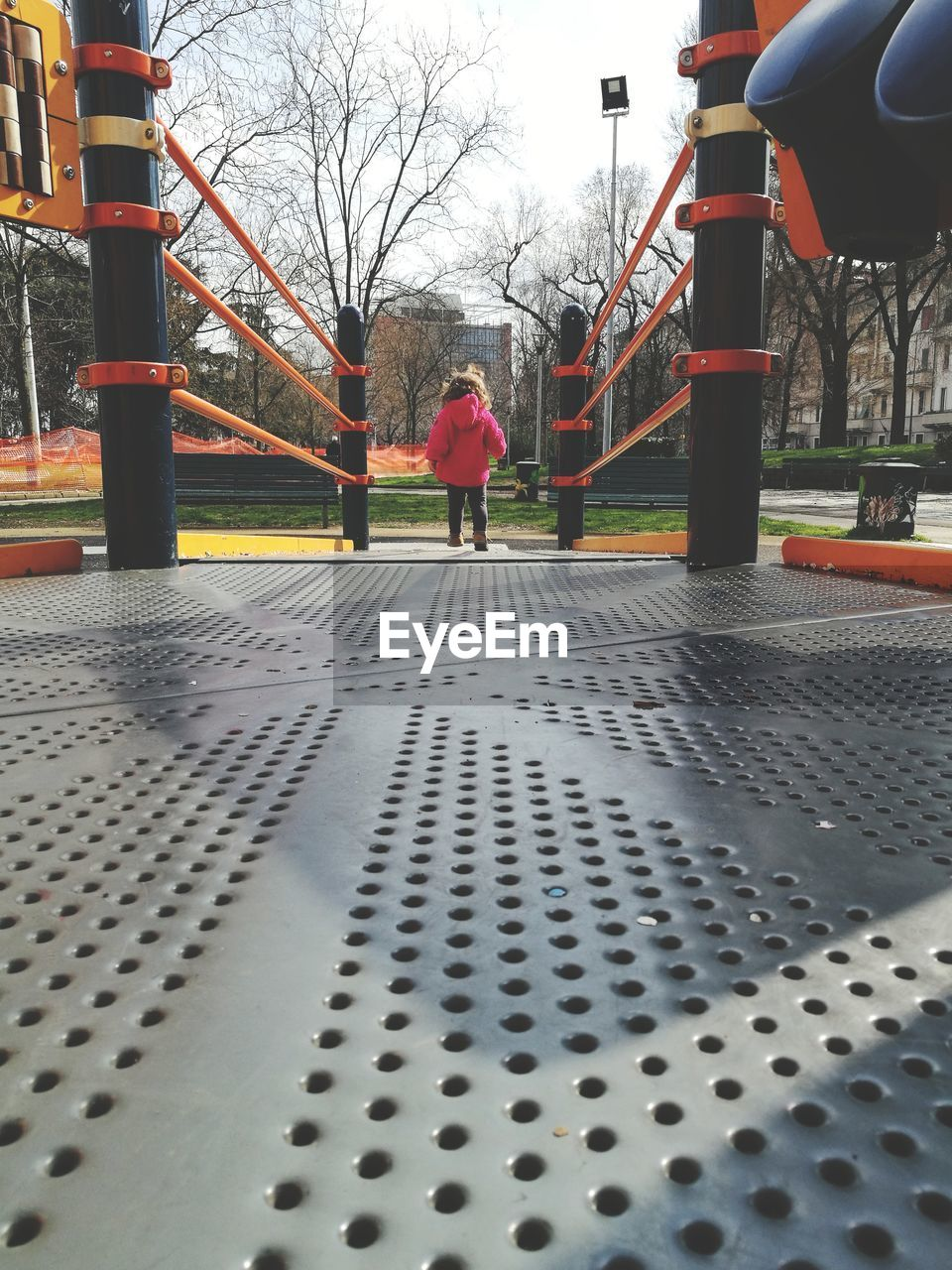 Rear view of girl at playground