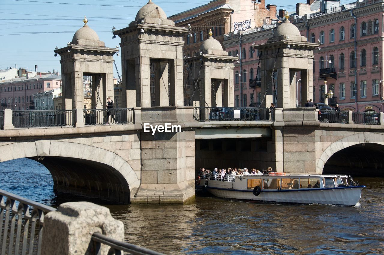 architecture, built structure, building exterior, water, transportation, nautical vessel, waterfront, bridge, mode of transportation, travel, city, river, tourism, bridge - man made structure, connection, travel destinations, day, group of people, nature, arch, outdoors, arch bridge
