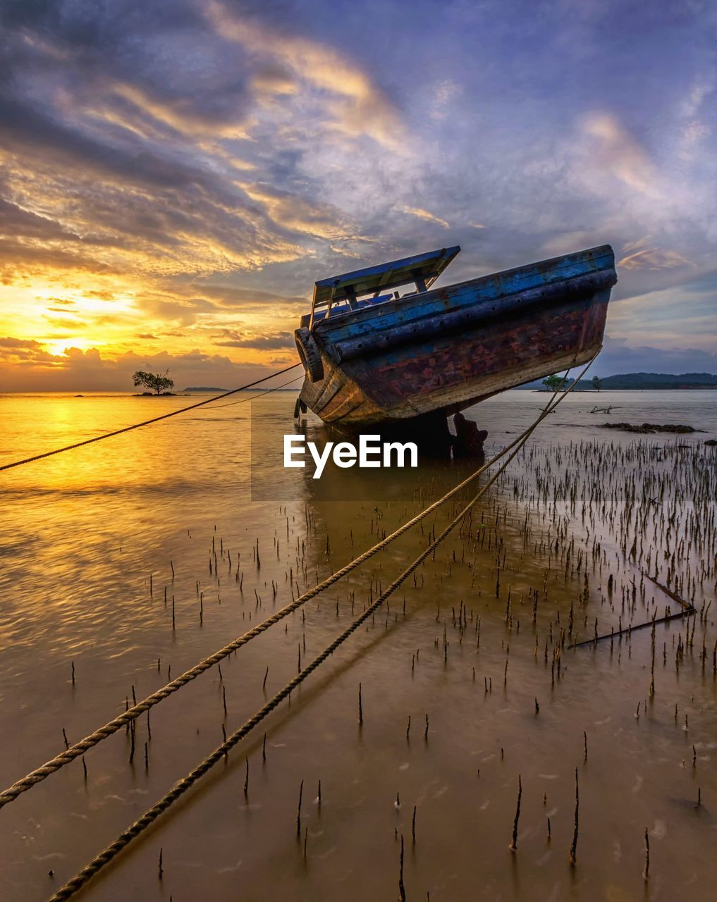 water, nautical vessel, sunset, sky, transportation, cloud - sky, mode of transportation, sea, reflection, nature, moored, beauty in nature, scenics - nature, abandoned, no people, tranquility, travel, ship, orange color, horizon over water, outdoors, sinking