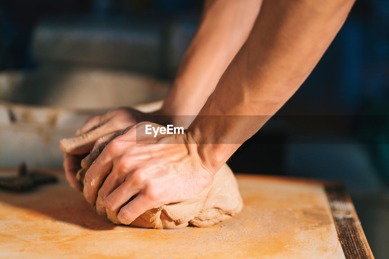 Cropped Hands Kneading Dough