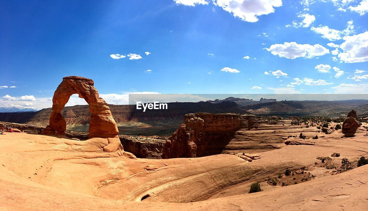 sky, rock formation, rock, tranquil scene, scenics - nature, rock - object, environment, physical geography, landscape, non-urban scene, tranquility, geology, solid, beauty in nature, nature, travel destinations, cloud - sky, travel, sunlight, remote, no people, climate, arid climate, eroded, outdoors, formation, sandstone
