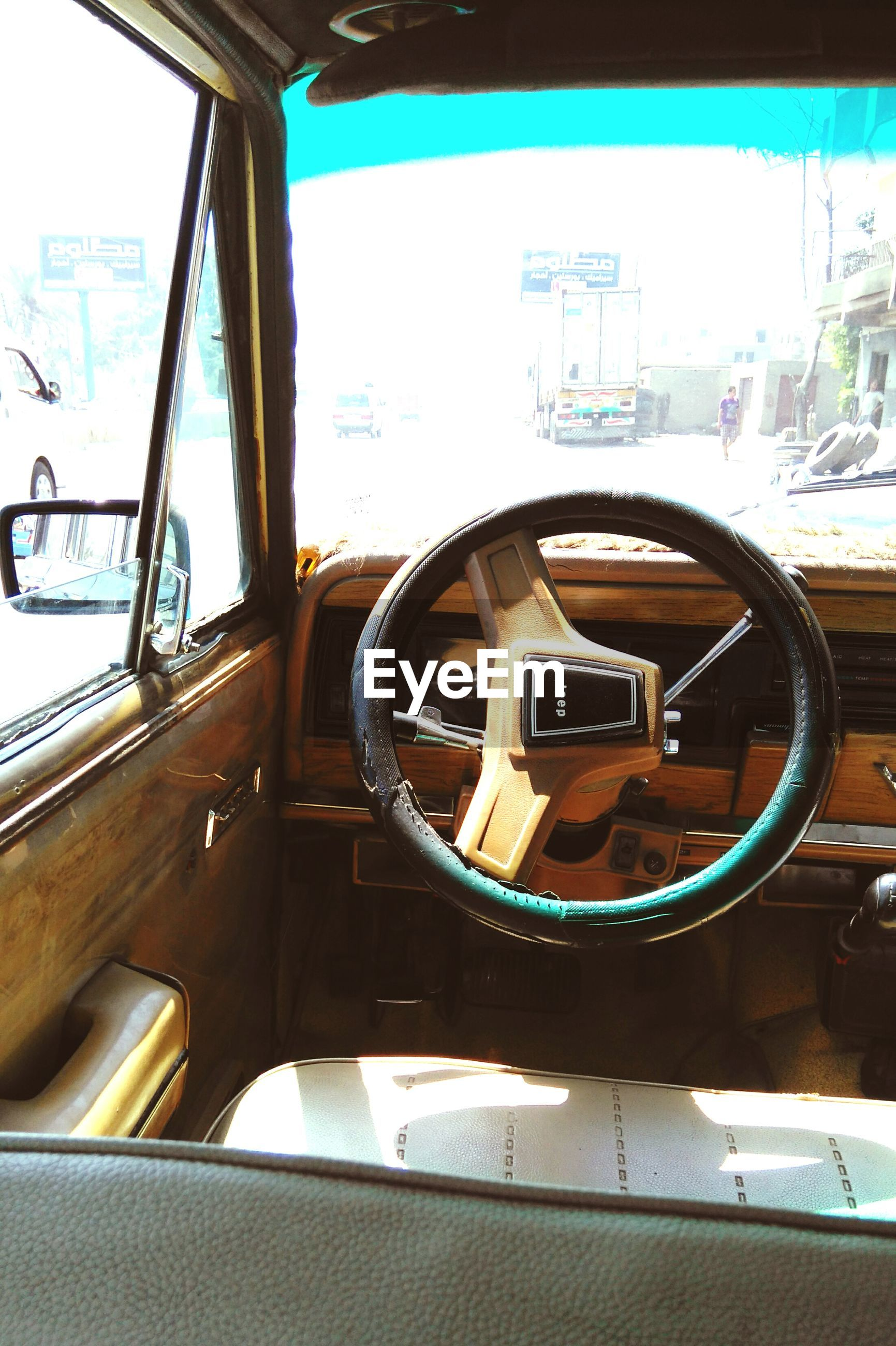 transportation, indoors, mode of transport, window, built structure, architecture, land vehicle, glass - material, vehicle interior, text, day, communication, railing, no people, car, western script, close-up, reflection, transparent, clear sky