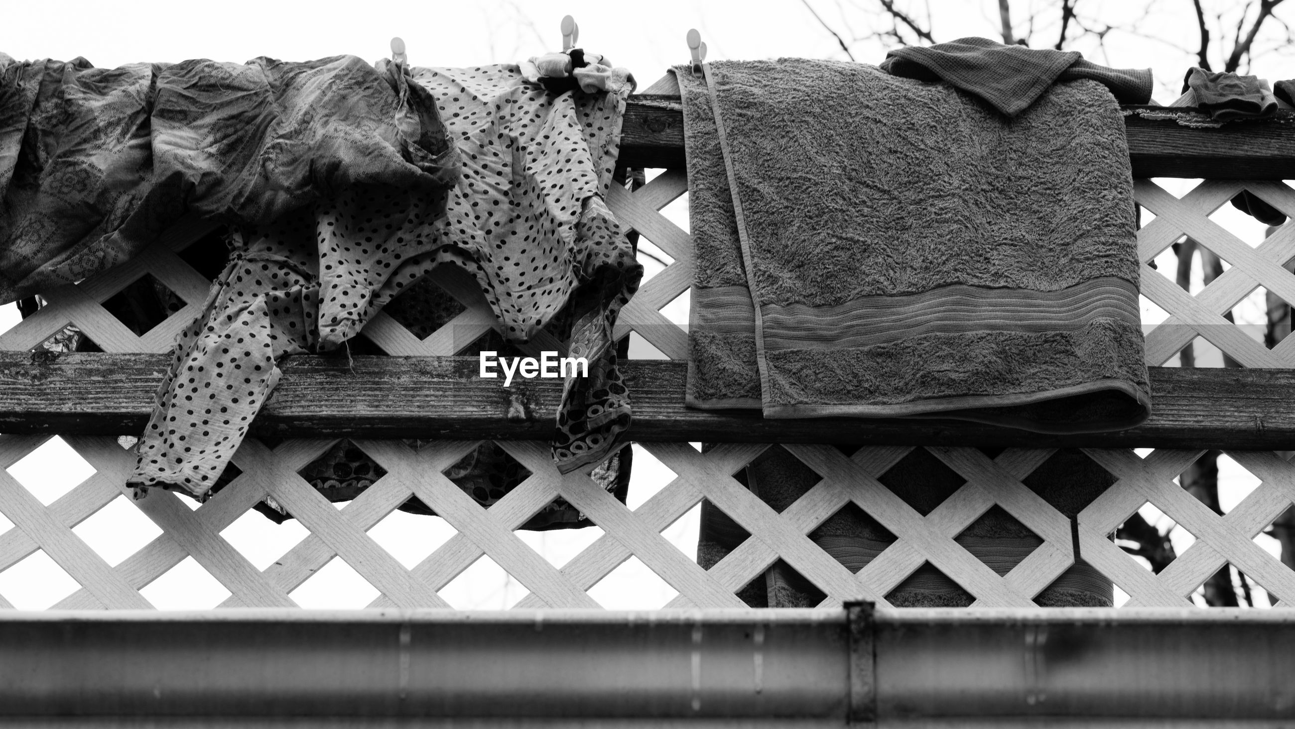 Low angle view of clothes drying on fence