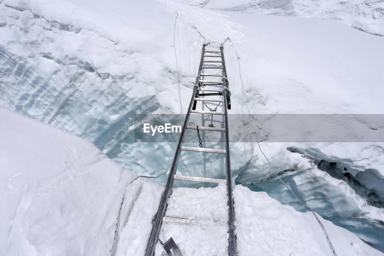 High Angle View Of Ladder On Snow Covered Ladder
