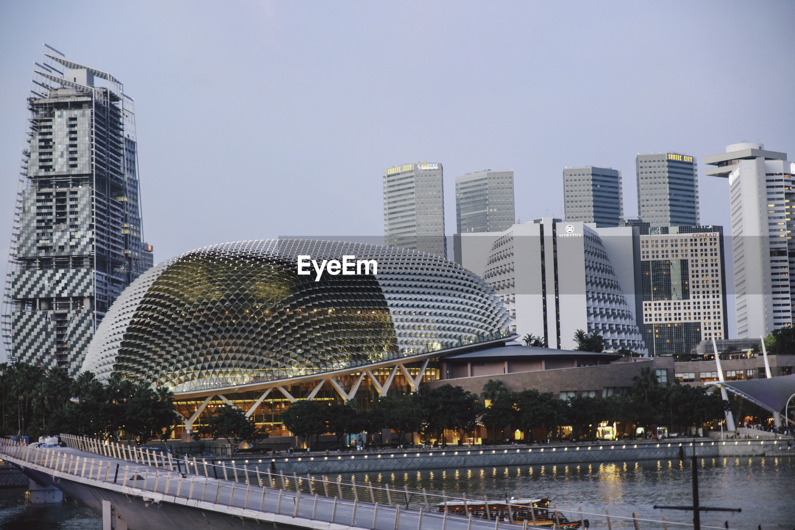 Esplanade theater in city by marina bay against sky