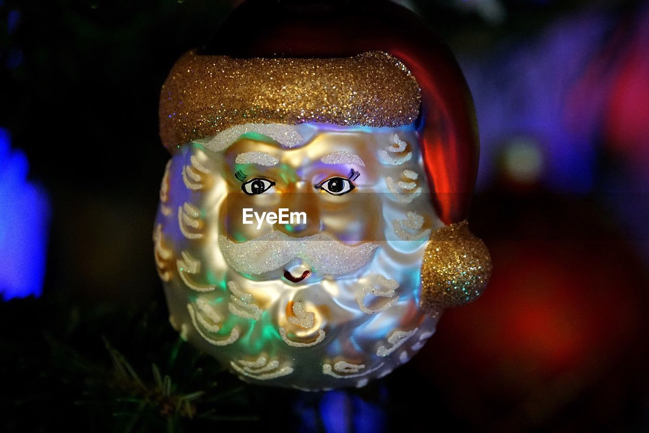 close-up, animal representation, focus on foreground, art and craft, no people, indoors, celebration, christmas decoration, illuminated, multi colored, day