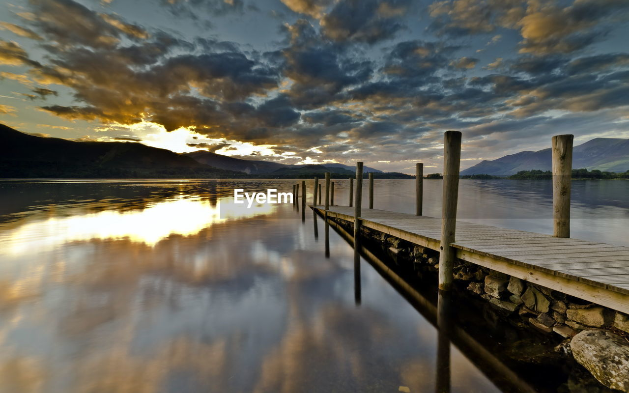 water, sky, cloud - sky, sunset, reflection, scenics - nature, beauty in nature, tranquility, tranquil scene, nature, railing, no people, lake, idyllic, wood - material, transportation, non-urban scene, pier, outdoors, wooden post