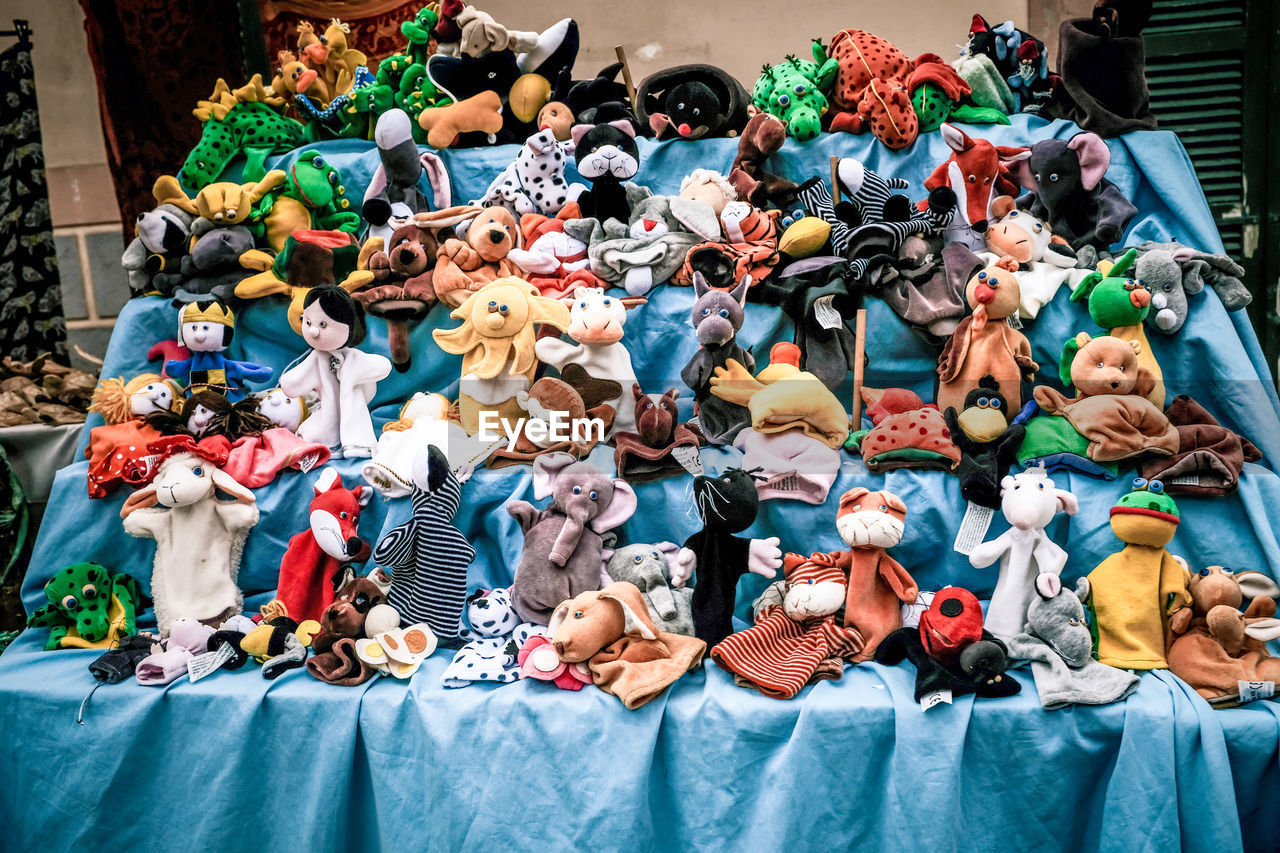 Various toys and puppets on market stall for sale