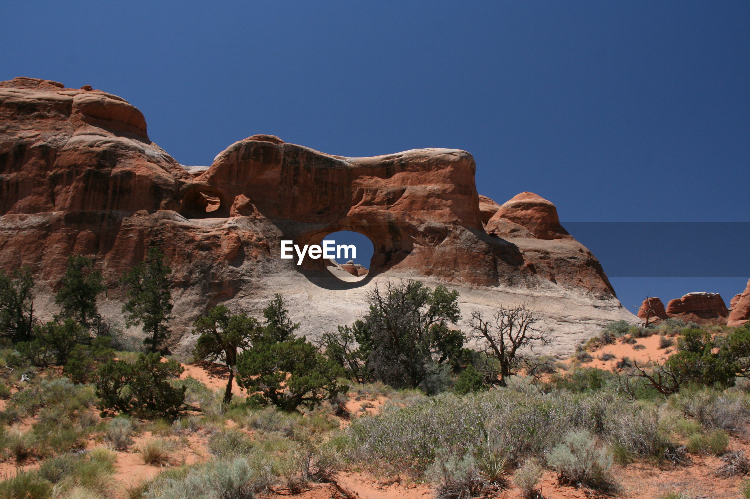 Rock formations against clear sky at arches national park