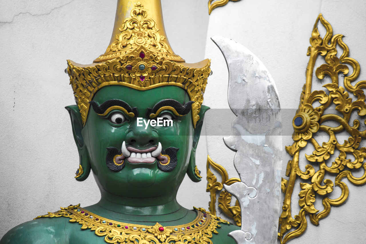 statue, sculpture, art and craft, spirituality, religion, human representation, gold colored, no people, multi colored, place of worship, idol, day, indoors, close-up