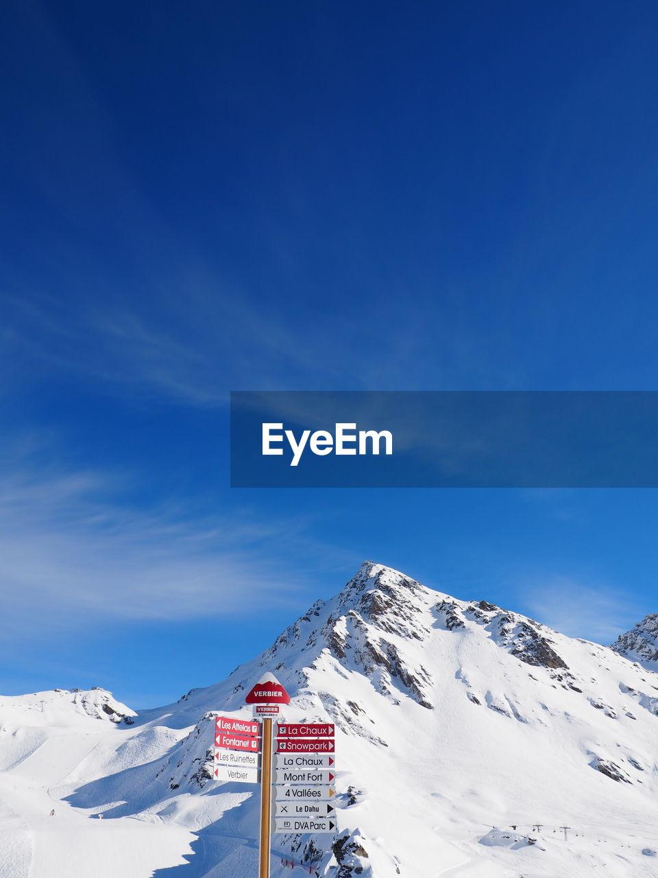 Signboard At Ski Resort Against Cloudy Sky
