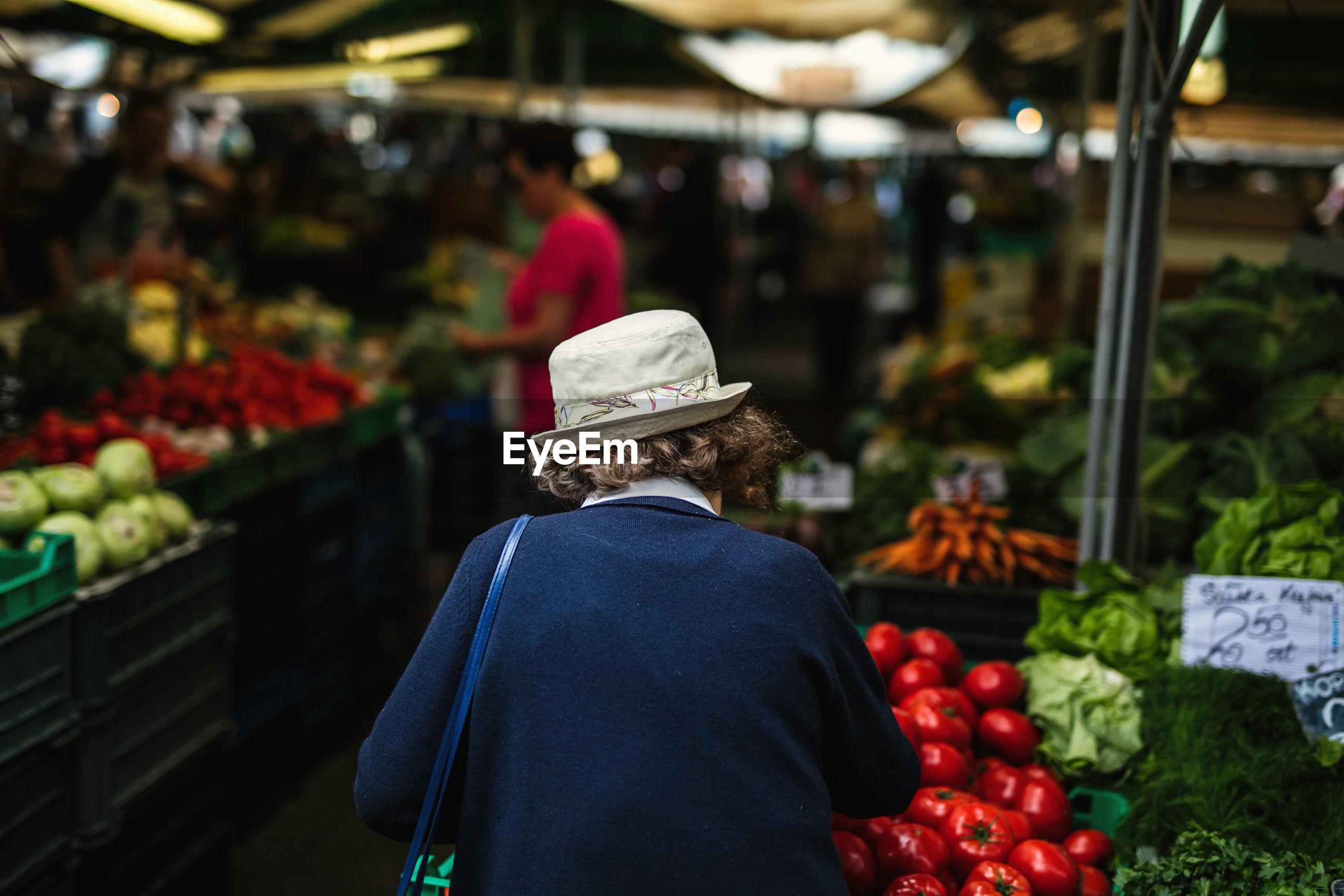 Rear view of woman at market