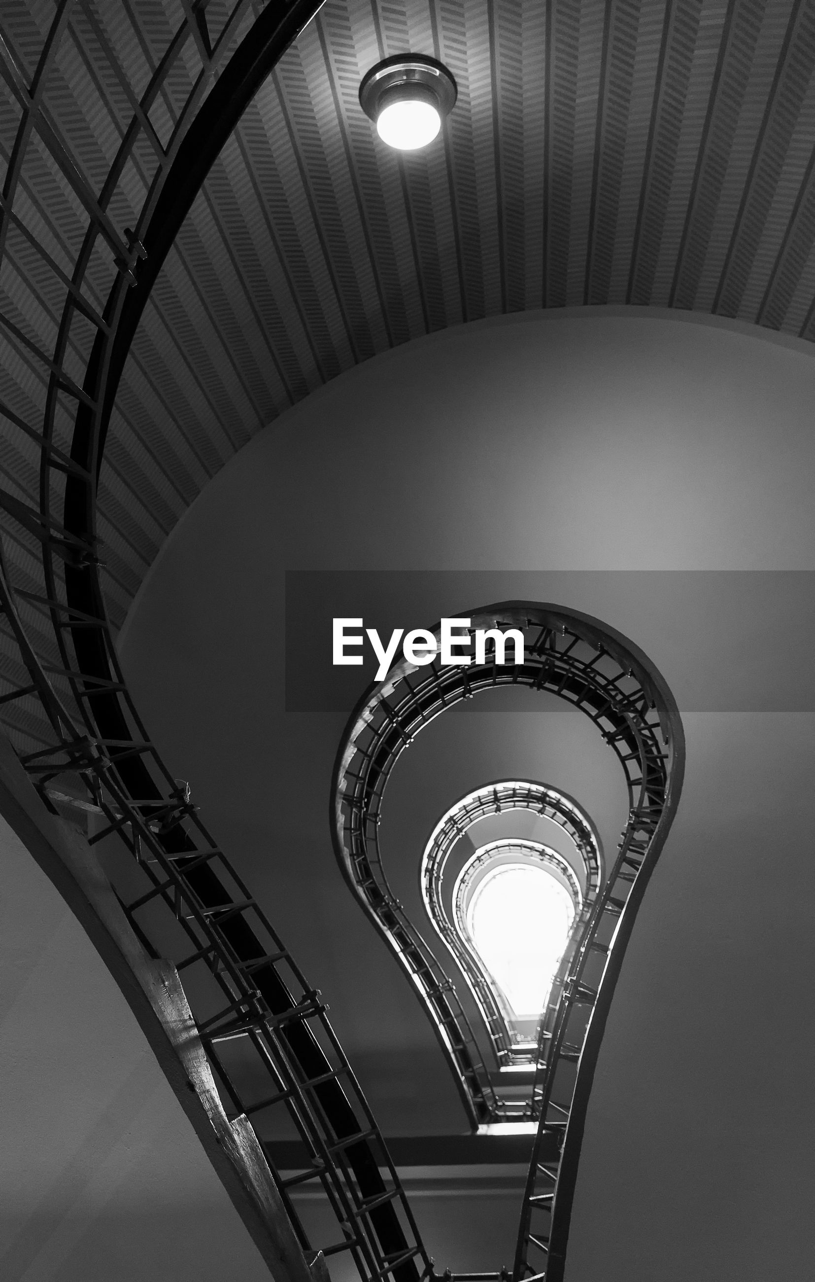 LOW ANGLE VIEW OF SPIRAL STAIRCASE OF LIGHT