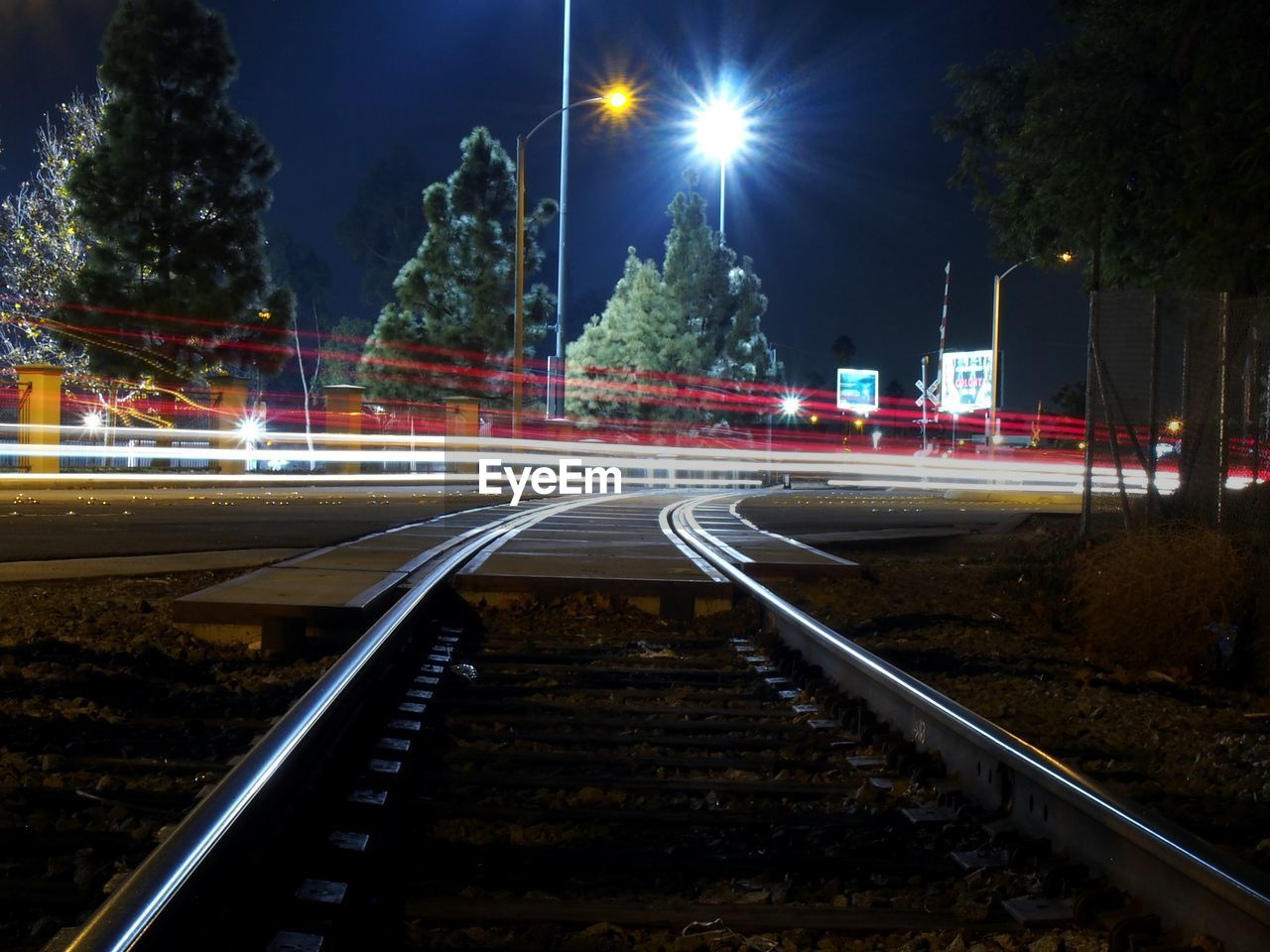 Light Trails Over Railroad Track At Night