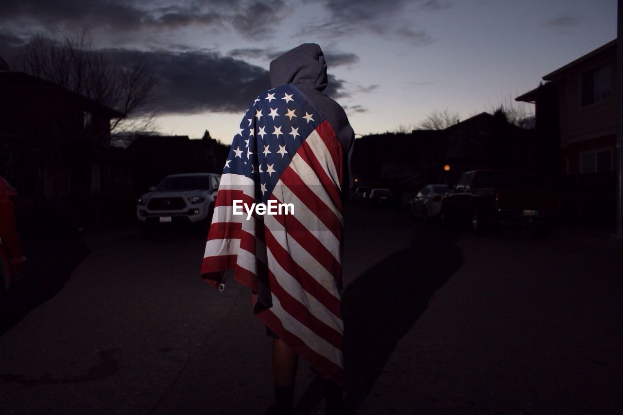 Boy Covered In The American Flag