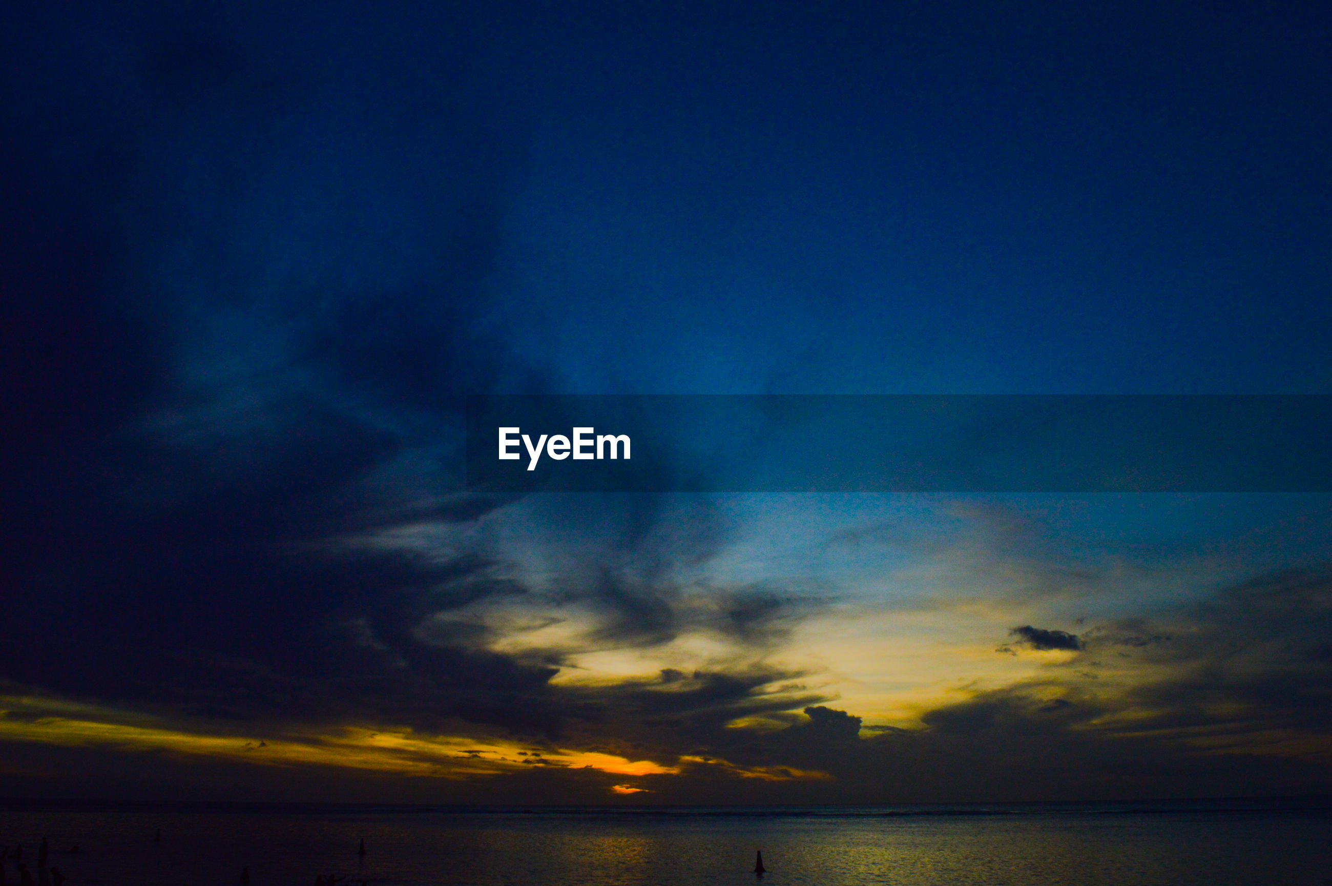 scenics, tranquil scene, sunset, tranquility, beauty in nature, sky, water, sea, nature, idyllic, silhouette, waterfront, blue, horizon over water, dusk, cloud - sky, orange color, calm, cloud, dramatic sky