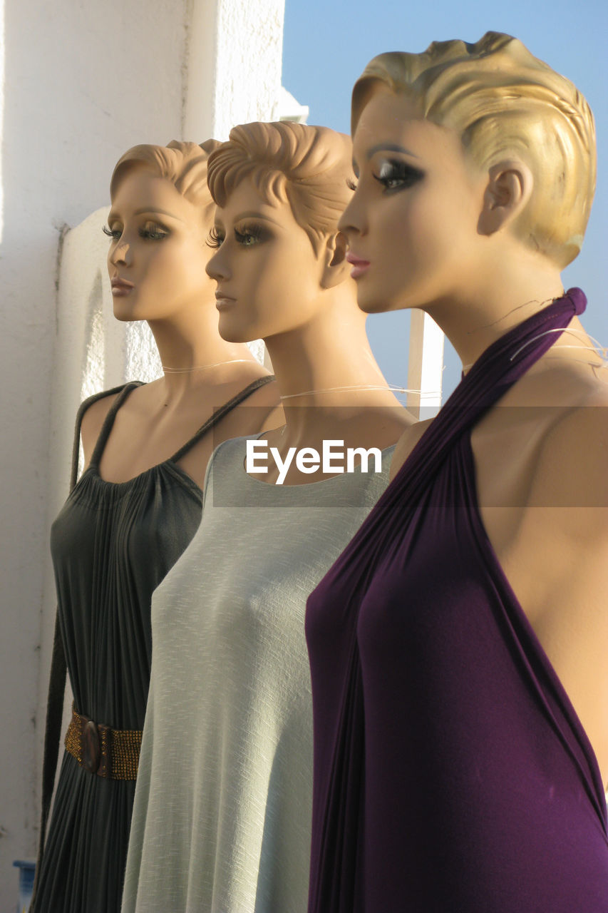 human representation, female likeness, fashion, representation, mannequin, indoors, beauty, clothing, young adult, hairstyle, retail display, young women, day, focus on foreground, store, in a row