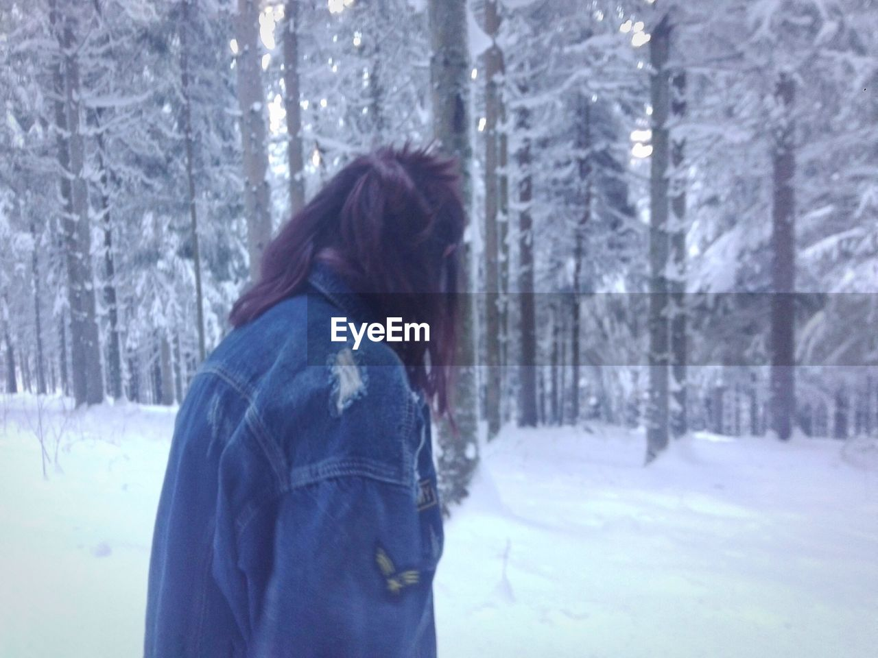 winter, cold temperature, snow, tree, forest, weather, nature, warm clothing, one person, outdoors, snowing, beauty in nature, frozen, day, rear view, tree trunk, leisure activity, focus on foreground, women, snowflake, real people, scenics, one woman only, spruce tree, young adult, adult, adults only, people