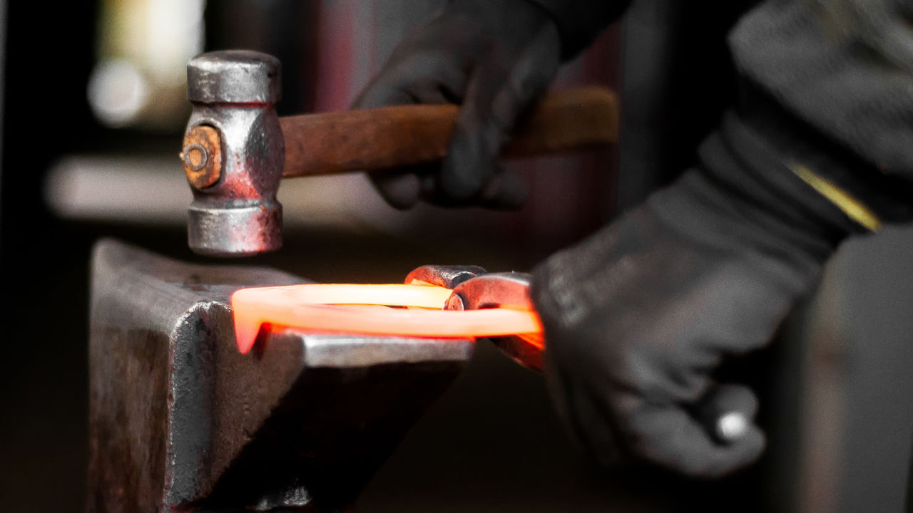 Cropped Image Of Worker Working On Hot Metal