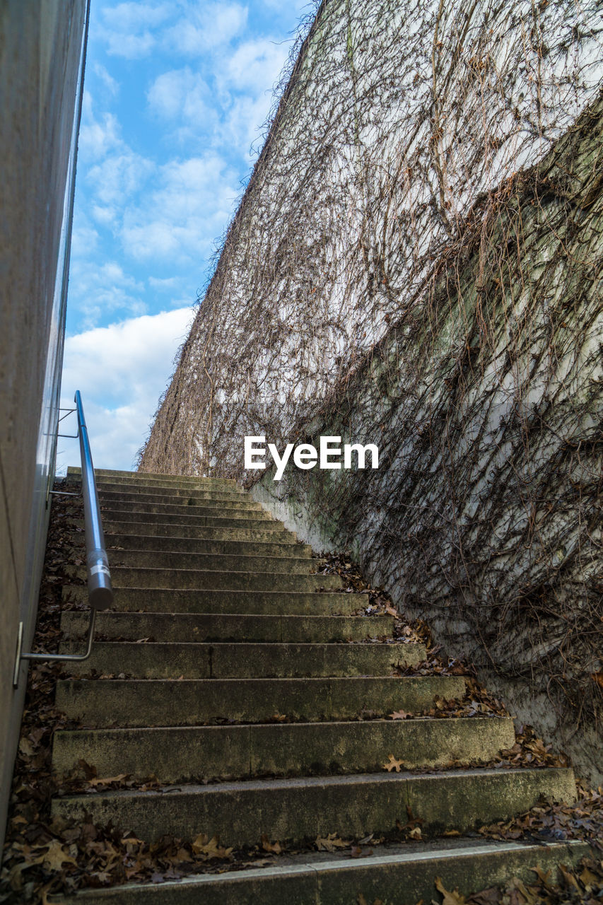 steps, staircase, steps and staircases, sky, low angle view, architecture, built structure, cloud - sky, no people, day, climbing, outdoors, nature