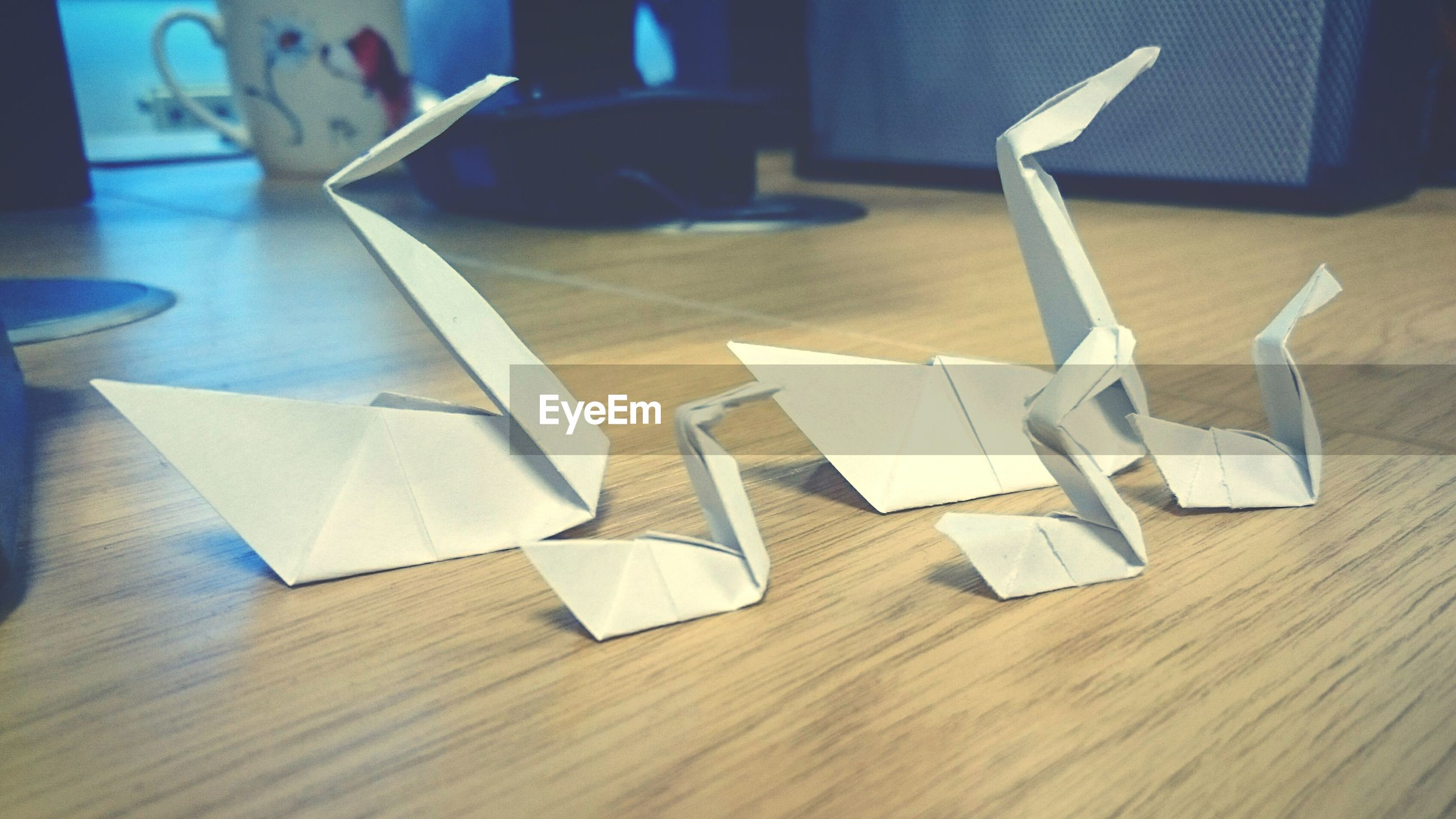 Side view of paper birds on table