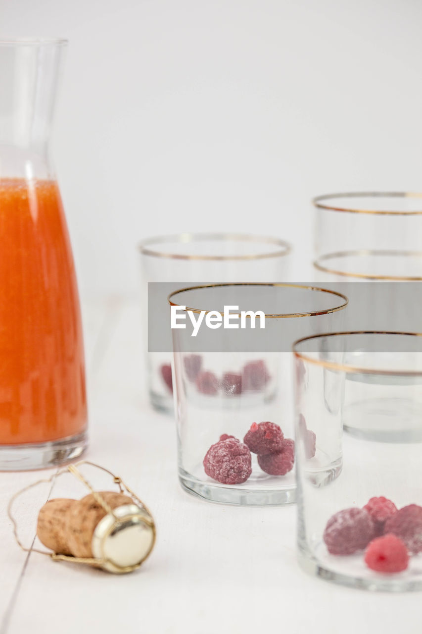 Close-Up Of Fruits In Drinking Glasses On Table