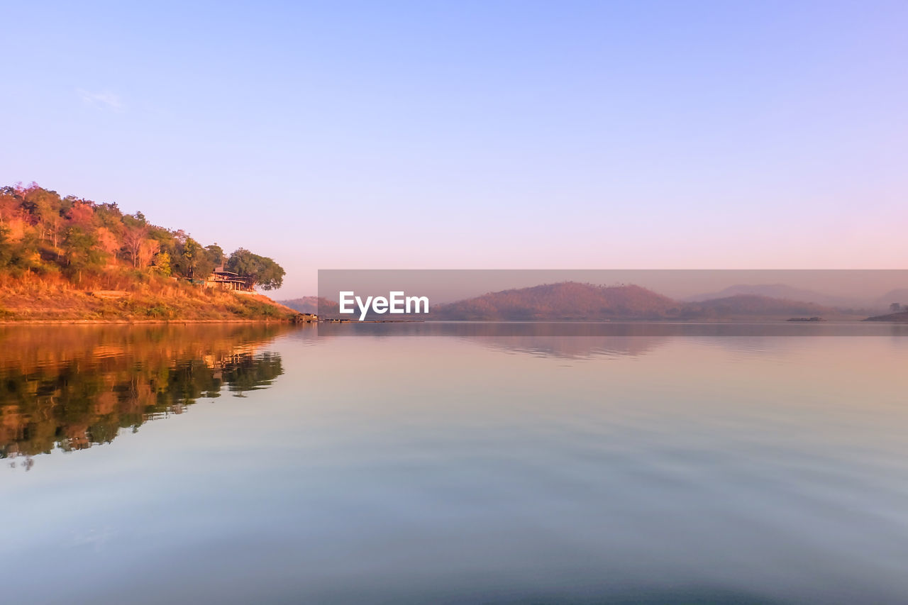 tranquility, sky, tranquil scene, scenics - nature, water, beauty in nature, reflection, lake, idyllic, waterfront, non-urban scene, nature, copy space, sunset, no people, orange color, tree, clear sky, plant, outdoors