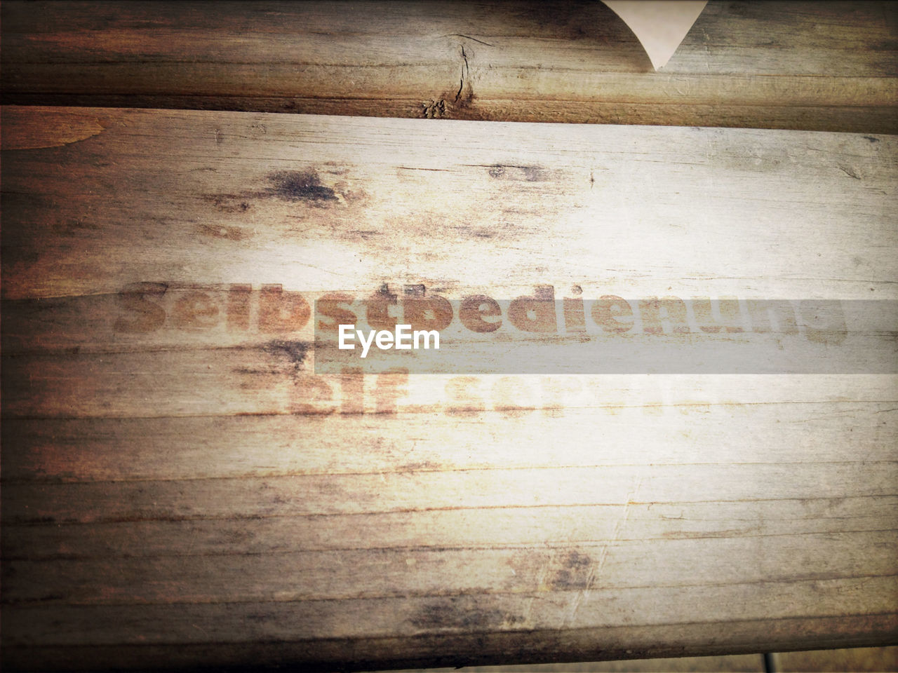 Sign on wooden plank