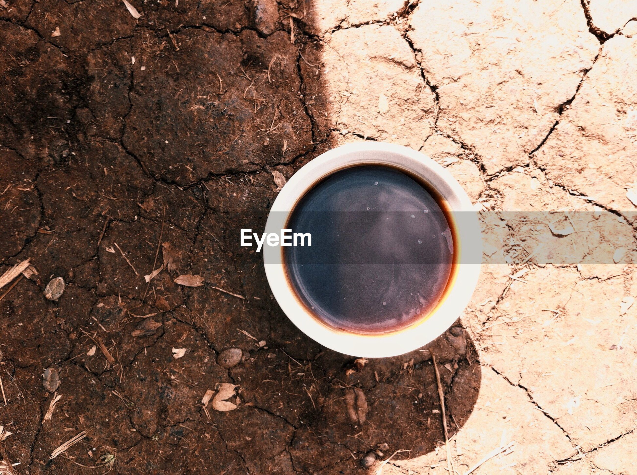 Directly above shot of coffee in cup on field
