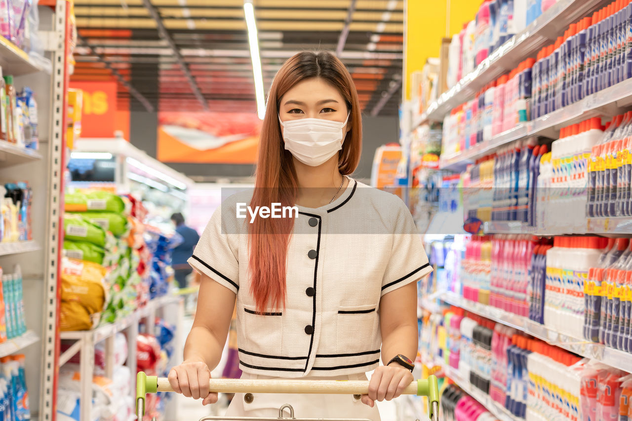 Portrait of woman wearing mask at shopping mall