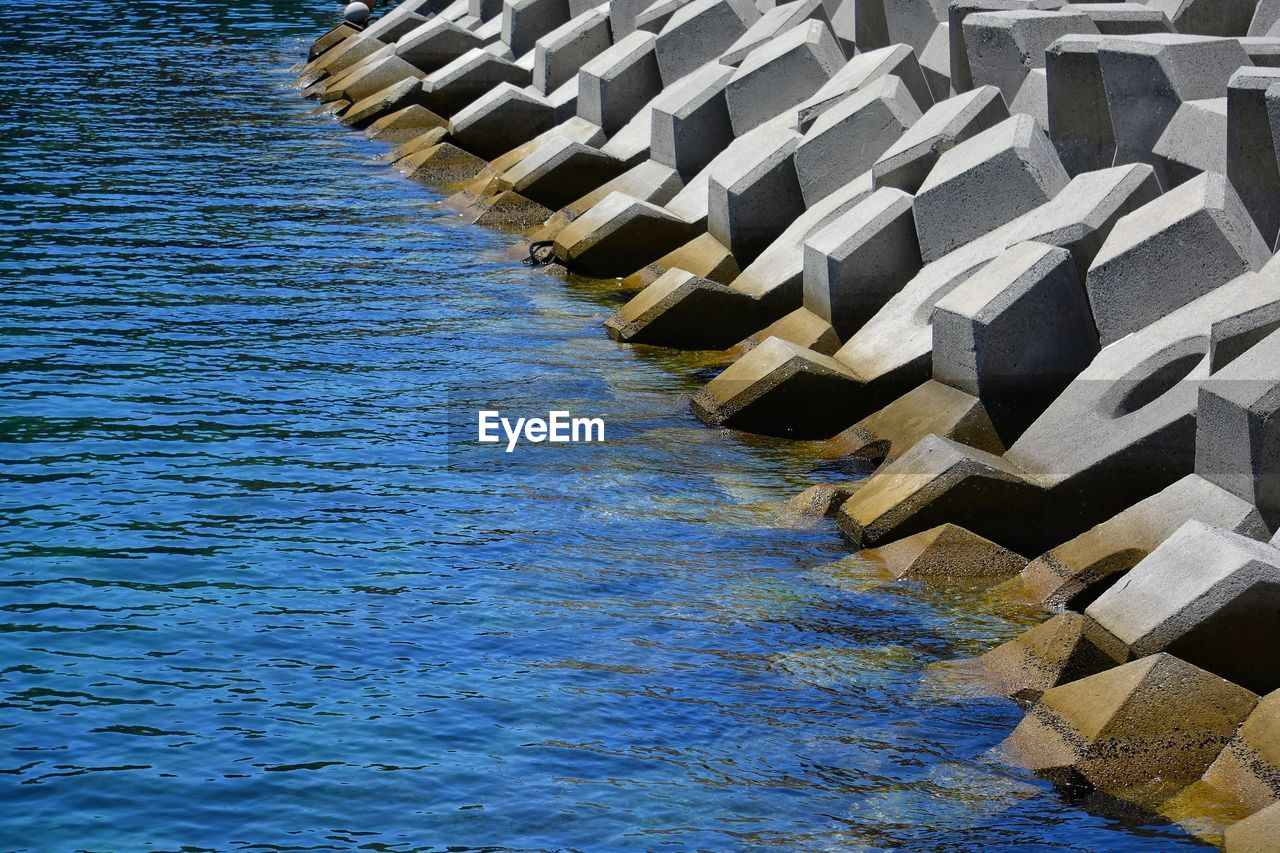 water, no people, nature, pattern, in a row, motion, waterfront, day, architecture, blue, outdoors, sea, repetition, high angle view, built structure, aquatic sport, beauty in nature, renewable energy, sport, flowing water, wheel