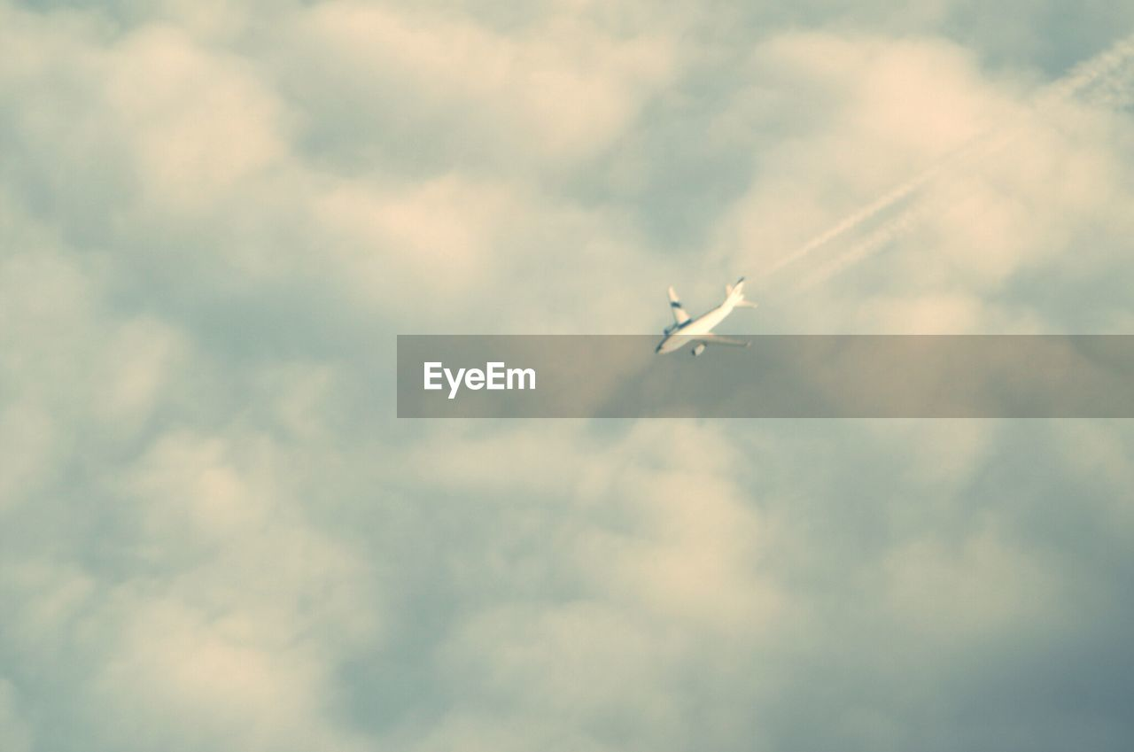 flying, sky, airplane, low angle view, mid-air, cloud - sky, no people, day, air vehicle, outdoors, transportation, nature, beauty in nature