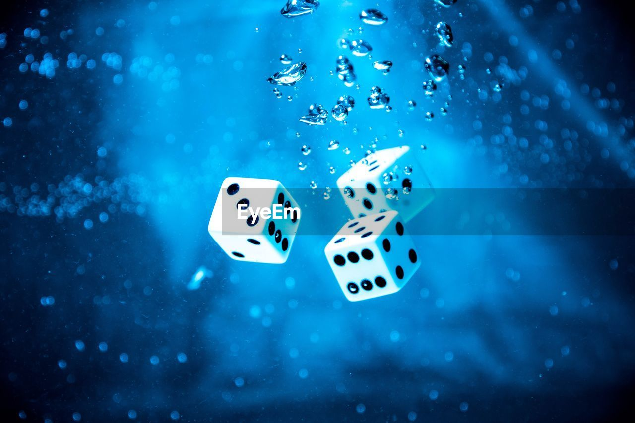 Close-Up Of Dices In Water