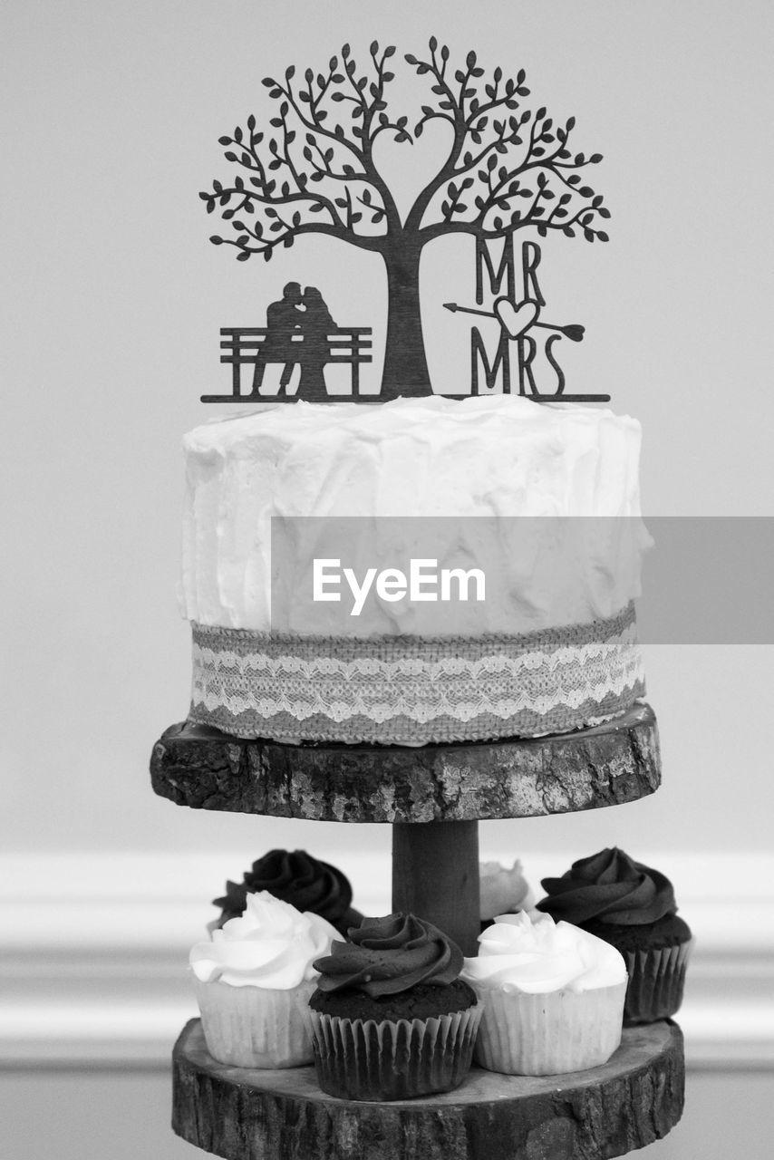 cake, sweet food, dessert, sweet, indulgence, baked, food and drink, celebration, food, wedding cake, temptation, indoors, unhealthy eating, event, no people, freshness, ready-to-eat, table, life events, still life, wedding cake figurine